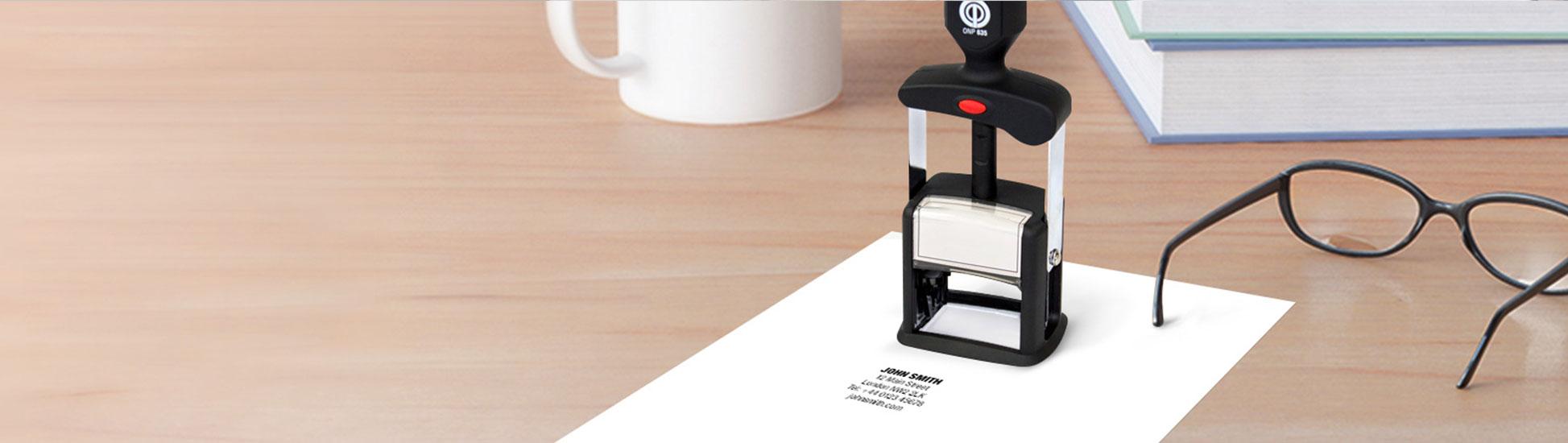 Custom metal stamper stamping white letter sized paper